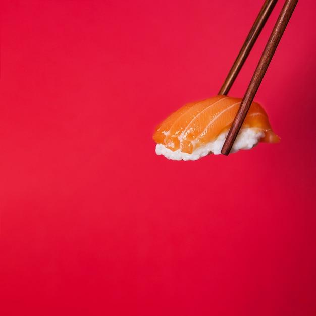Chopsticks with sushi Free Photo