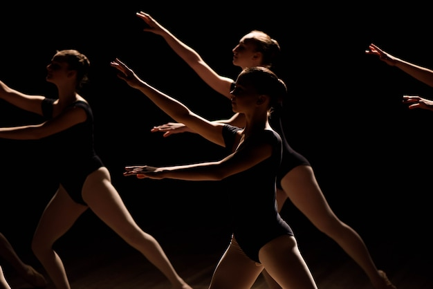 A choreographed dance of a group of graceful pretty young ballerinas Premium Photo