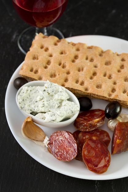 Chorizo with cheese, olives and toasts Premium Photo