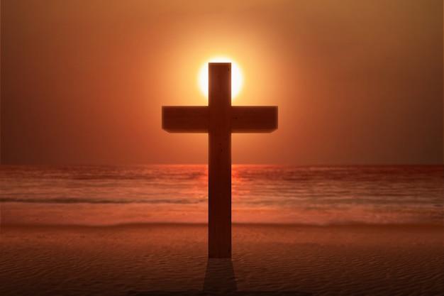 Christian cross on the beach Premium Photo