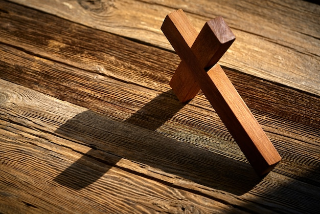 Christian cross on wood over wooden Premium Photo