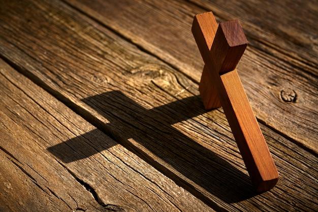 Christian cross on wood over wooden Premium Photo