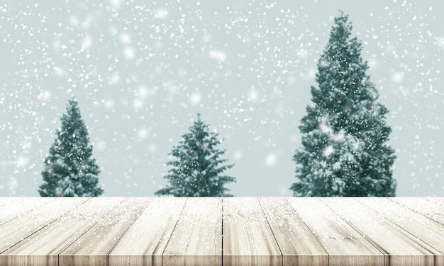 christmas and new year background wooden table top with blur christmas tree pine or fir