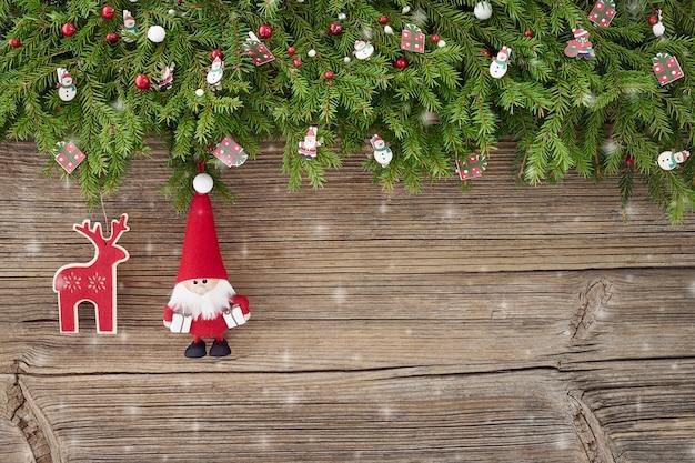 Christmas background. christmas decoration with santa on white wooden background. copy spa Premium Photo