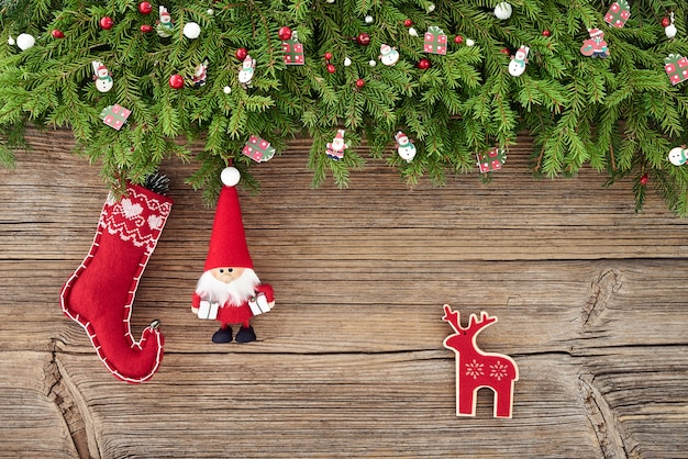 Christmas background. christmas decoration with santa on wooden background. copy space, top view Premium Photo