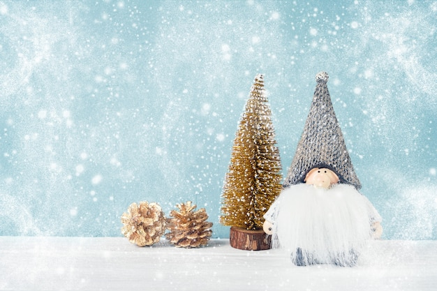 Christmas background. christmas toys on snow background. copy space Premium Photo
