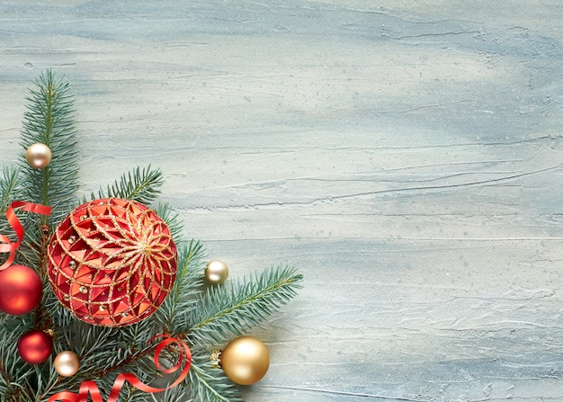 Christmas background: corner decorated with fir twigs and christmas baubles Premium Photo