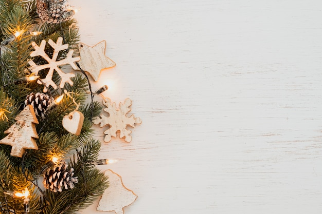 christmas background fir leaves rustic elements decorating white wood table creative flat layout top view 1484 2240