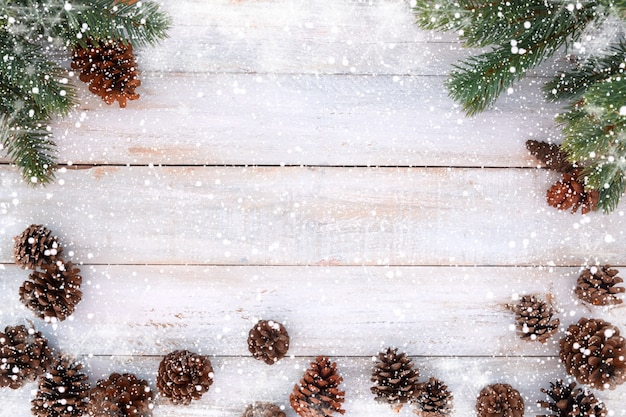 christmas background fir tree and pine cones decorating rustic elements on white wood table with - Rustic Christmas Background