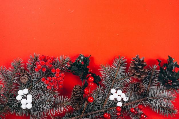 Christmas background layout on red background Free Photo