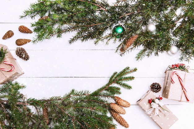 Christmas background with decorations and gift boxes on wooden board Premium Photo
