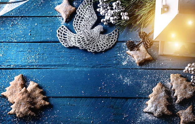 Christmas background with decorations on wooden board Premium Photo