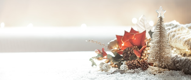 Christmas background with details of festive decor on a blurred background copy space. Free Photo