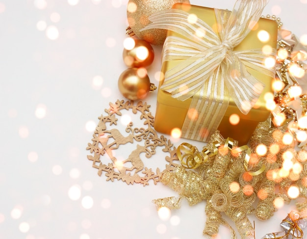 Christmas background with gift and decorations Free Photo