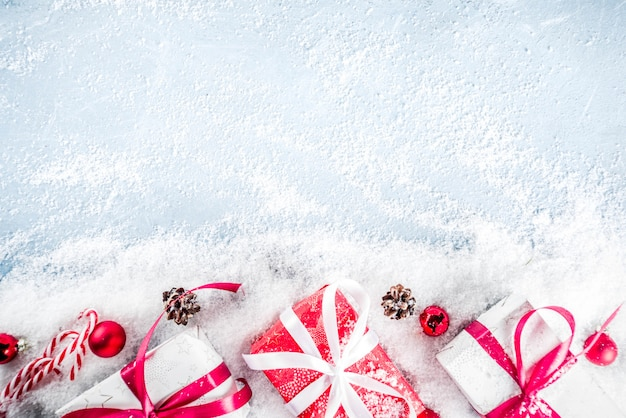 Christmas background with gifts and artifical snow Premium Photo