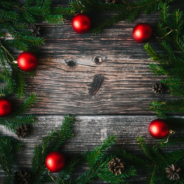 Christmas background with red balls, fir branches and pine cones Premium Photo