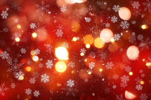 Christmas background with snow and bokeh lights Free Photo