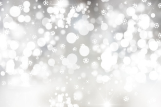 Christmas background with snowflakes and bokeh lights Free Photo