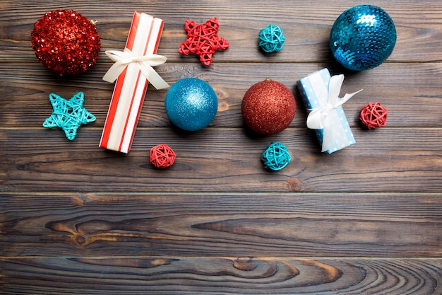 Christmas ball, gift and creative decorations on wooden background Premium Photo