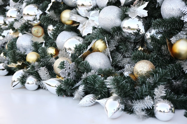Christmas ball hang on green pine tree new year party background . Premium Photo