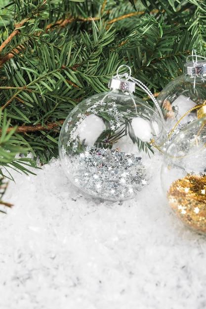 Christmas balls near fir twig Free Photo
