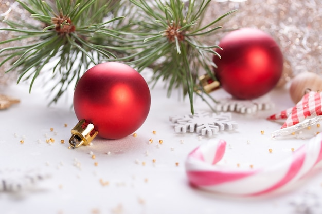 Christmas balls with candy bars Free Photo