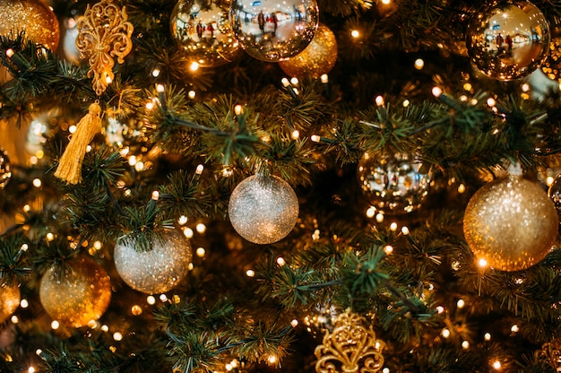 Christmas bauble hangs from a tree Premium Photo