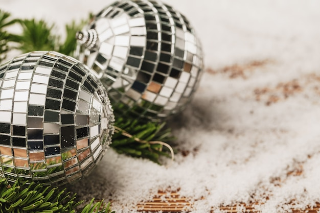 Christmas bauble on snowy wooden table. christmas concept Premium Photo