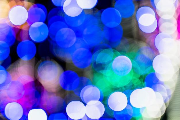 Christmas bokeh on dark background Free Photo