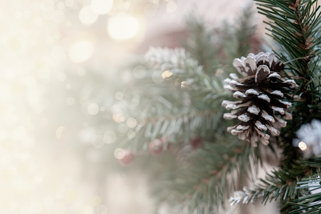 Christmas bokeh effect background with pine branches, cones, and space for inscription Free Photo