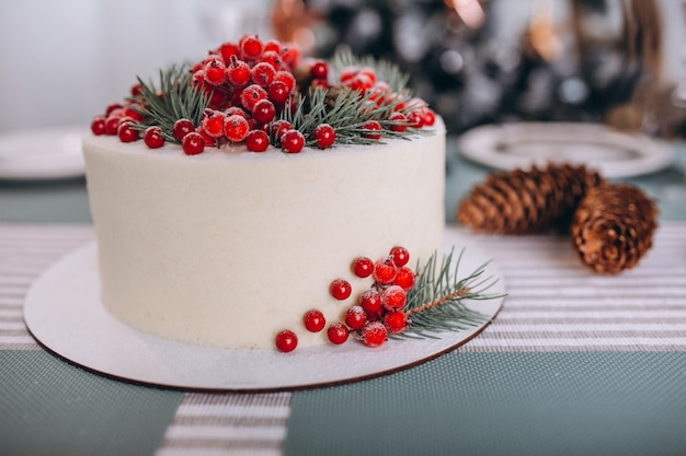 Christmas cake decorated with red berries Free Photo
