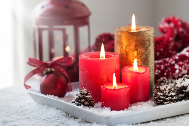 Christmas candles with christmas decorations, christmas or new year atmosphere, selective focus, horizontal