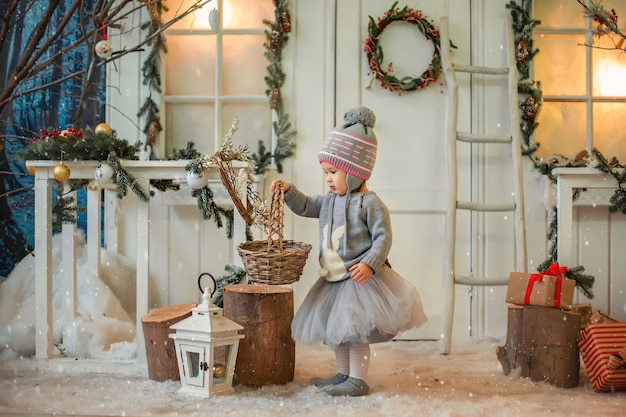 Christmas card with a little girl. Premium Photo