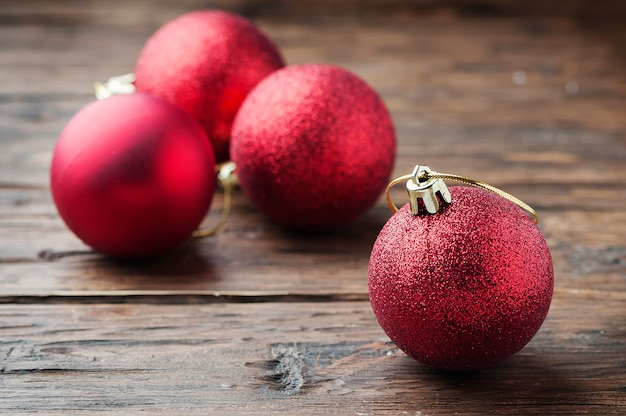 Christmas card with red balls on the wooden table Premium Photo