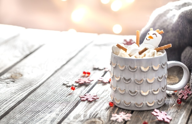 Christmas cocoa concept with marshmallows on a wooden background in a cozy festive atmosphere Free Photo