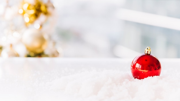 Christmas composition of bauble on table Free Photo