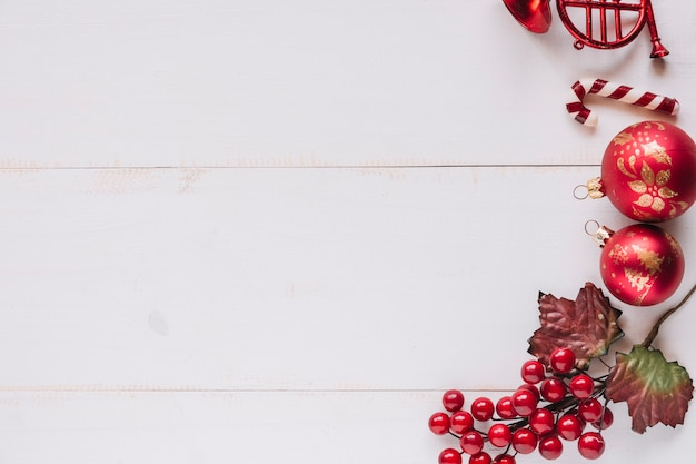 Christmas composition of baubles with red berries Free Photo