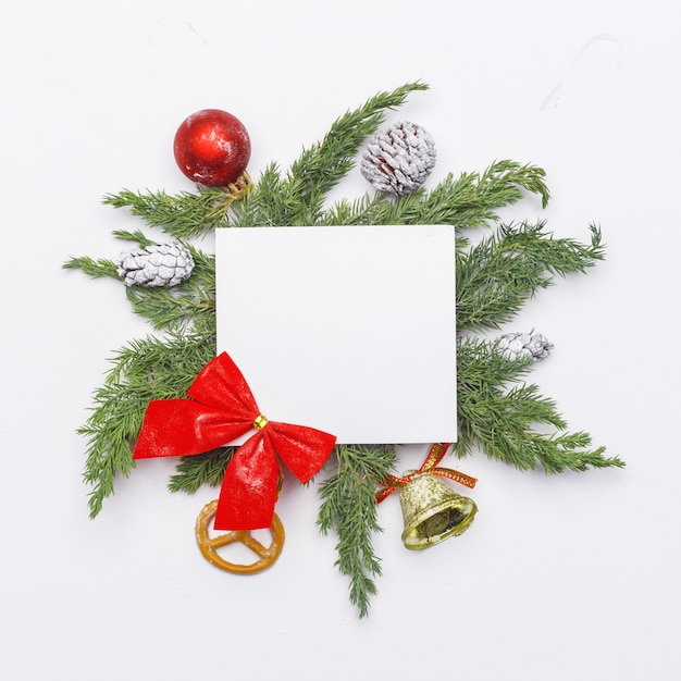 Christmas composition of coniferous branches, decorations and sweets on light background. flat lay. top view nature new year concept. copy space. Premium Photo