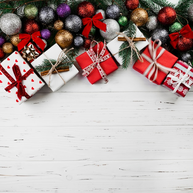 Christmas composition of gift boxes and baubles Free Photo