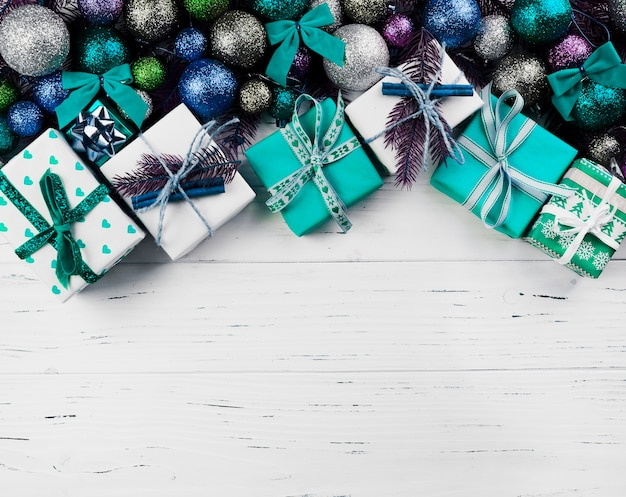 Christmas composition of gift boxes and colourful baubles Free Photo