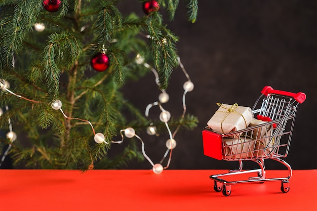 Picture A Christmas.Christmas Composition Mini Trolley With Gift Boxes Near A