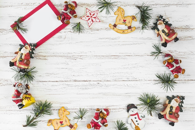 Christmas composition of paper with toys Free Photo