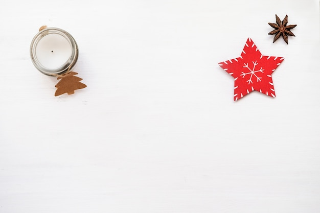 Christmas composition. red decorations on white background. christmas candlestick Premium Photo