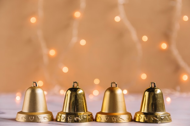 Christmas composition of small metallic bells Free Photo