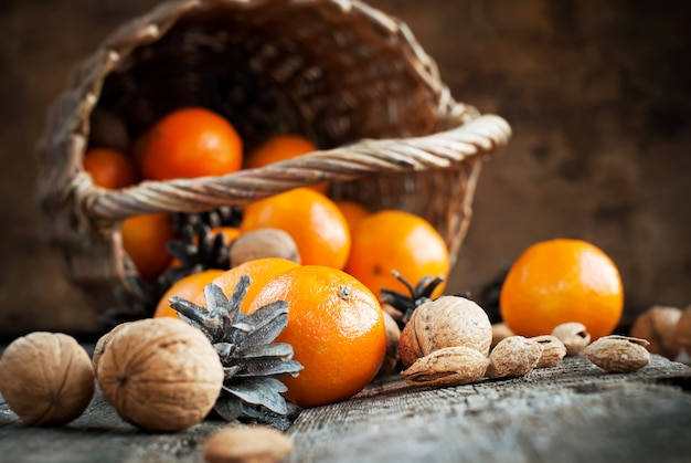 Christmas composition with basket, fruits, nuts Premium Photo
