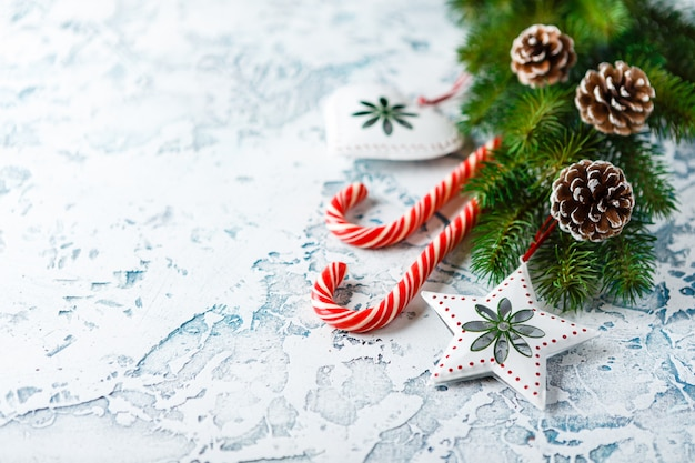 Christmas composition with fir branch, christmas decorations, candy canes Premium Photo