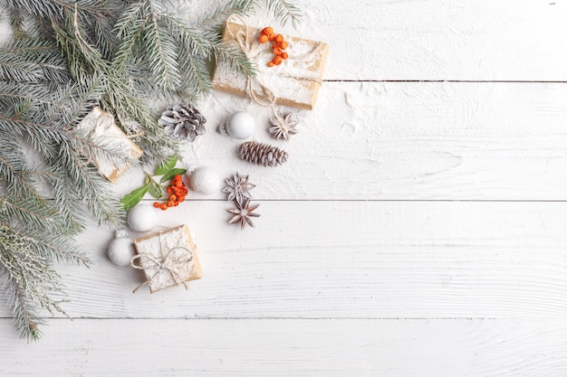 Christmas composition with frame of fir branches, christmas decorations and pine cones. flat lay, top view Premium Photo