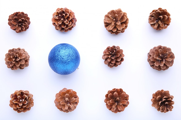 Christmas composition with pine cones and blue christmas ball on white background Premium Photo