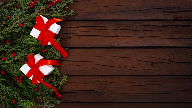 Christmas composition on a wooden background Free Photo