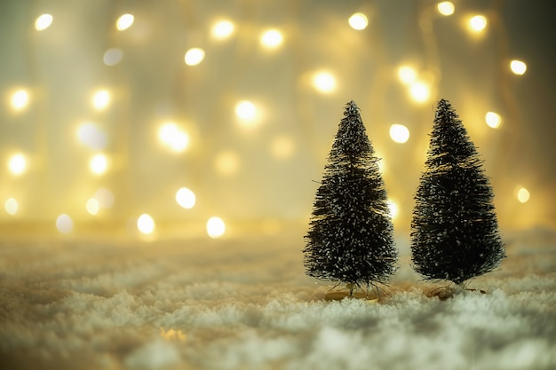 Christmas concept. christmas decoration, pine cone on snow with sky background. soft focus